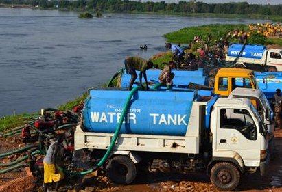 Water sellers fetch water from the Nile near Juba Bridge.